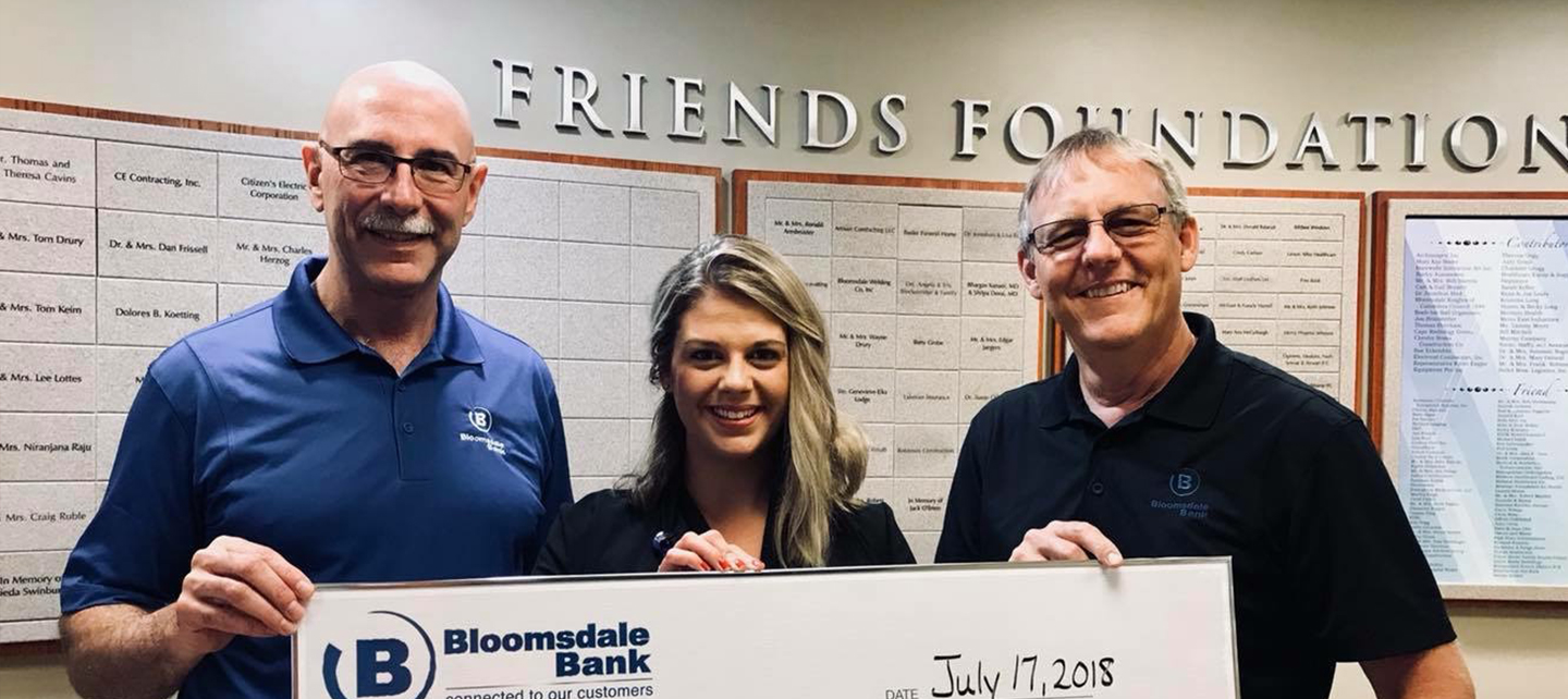 Bloomsdale Bank employees with check for hospital
