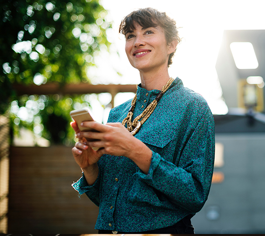 woman looking happy and inspired with smartphone